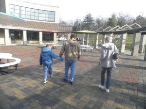 daddy holds Jonah's hand and grandma walks beside them - away from his residence and across the campus to the car.