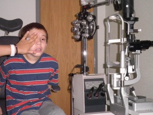 Jonah, last week at the same glaucoma doc he flipped out on today.  Here they are testing his left eye.  He can't see out of the eye and is about to give some bullshit answer.