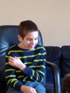 Later that same day: Jonah has a calm moment and even, thank God, a smile.